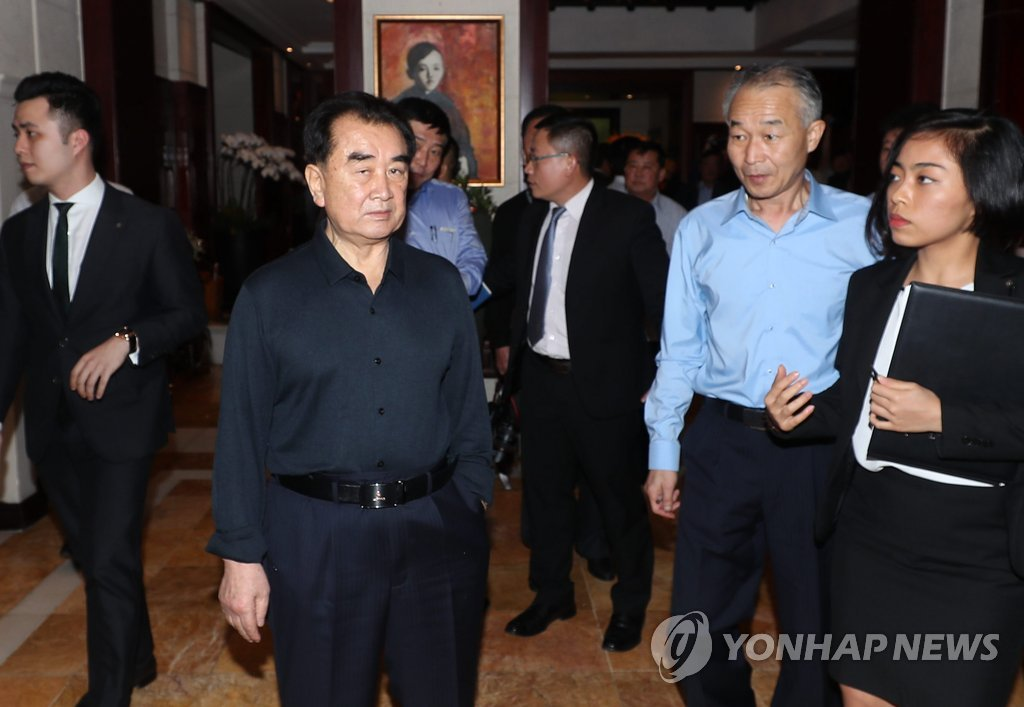 Kim Chang-son (L), an official at North Korea's State Affairs Commission, enters a hotel in Hanoi on Feb. 16, 2019, after arriving in Vietnam to prepare for a second summit between the United States and North Korea. (Yonhap)