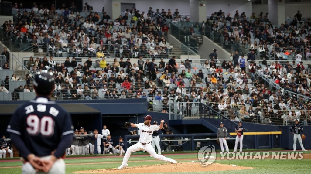 Fans at Gocheok Sky Dome in Seoul attend a Korea Baseball Organization preseason game between the home team Kiwoom Heroes and the Doosan Bears on March 17, 2019. (Yonhap)