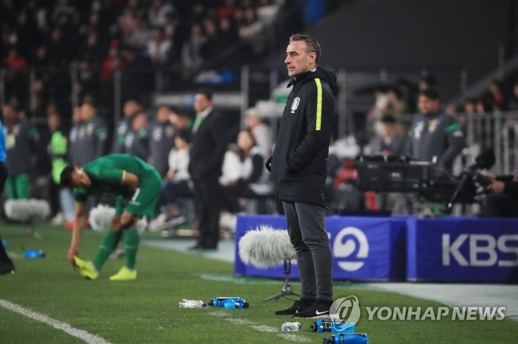South Korea men's football head coach Paulo Bento watches his team in action against Bolivia in a men's friendly football match at Munsu Football Stadium in Ulsan, 400 kilometers southeast of Seoul, on March 22, 2019. (Yonhap)