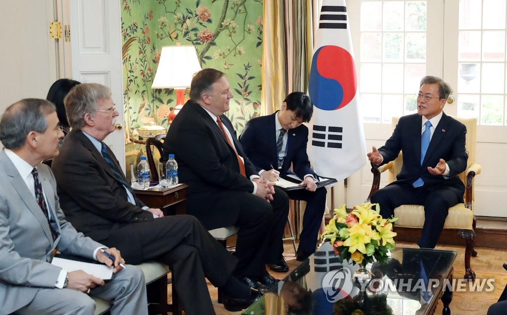 South Korean President Moon Jae-in (R) speaks in a meeting with U.S. Secretary of State Mike Pompeo (3rd from R) and National Security Adviser John Bolton (2nd from L) at the United States' state guest house, Blair House, on April 11, 2019. (Yonhap)