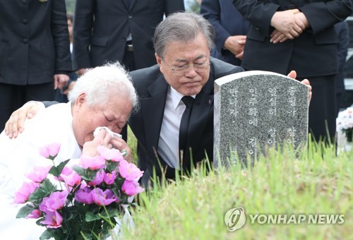 Moon consoles family member of victim in Gwangju uprising crackdown