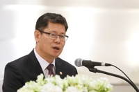 Unification minister hopes better inter-Korean ties lead to resumption of nuclear talks