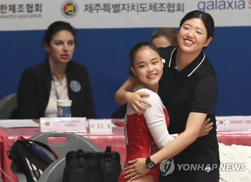 (LEAD) Teen gymnast set to be immortalized in int'l scoring book