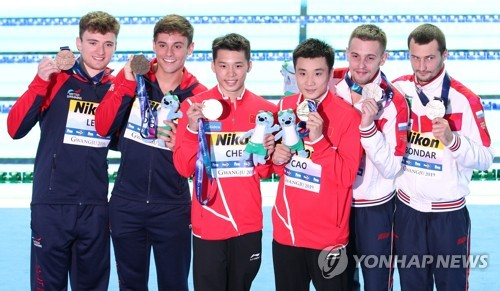 Chinese duo takes gold in synchronized 10m platform