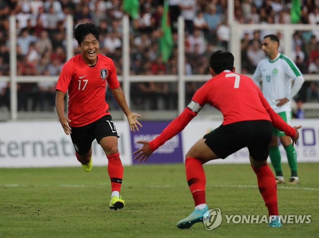 Na Sang-ho of South Korea (L) runs toward his teammate Son Heung-min after scoring a goal against Turkmenistan during the teams' Group H match in the second round of the Asian qualification for the 2022 FIFA World Cup at Kopetdag Stadium in Ashgabat, Turkmenistan, on Sept. 10, 2019. (Yonhap)