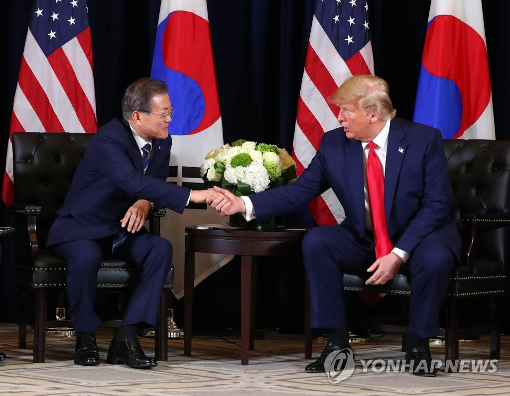 This file photo, dated Sept. 24, 2019, shows South Korean President Moon Jae-in (L) shaking hands with U.S. President Donald Trump during a meeting in New York. (Yonhap)