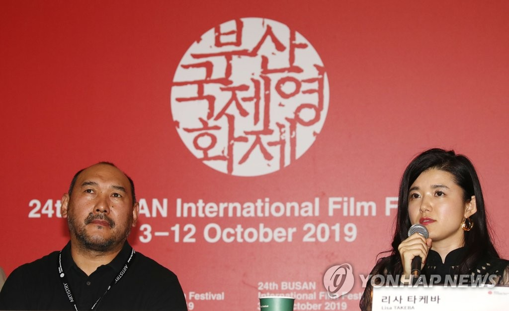 "Yerlan Nurmukhambetov (L) and Lisa Takeba (R), co-directors of ""The Horse Thieves. Roads of Time,"" hold a press conference of the Busan International Film Festival in Busan on Oct. 3, 2019. (Yonhap)"