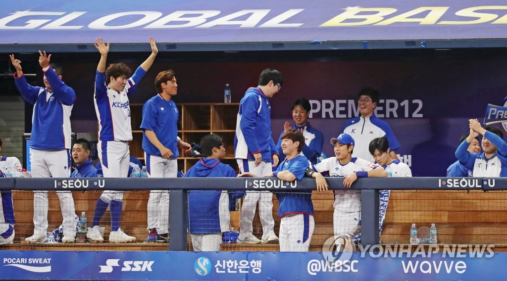 South Korean players celebrate a run against Cuba in the bottom of the fifth of the teams' Group C game at the World Baseball Softball Confederation (WBSC) Premier12 at Gocheok Sky Dome in Seoul on Nov. 8, 2019. (Yonhap)