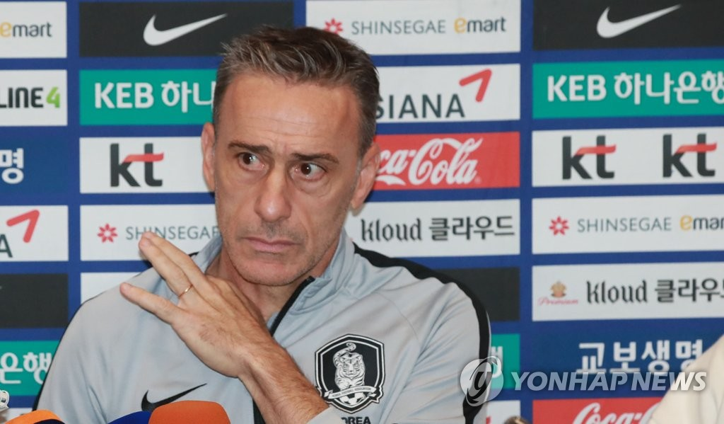 Paulo Bento, head coach of the South Korean men's national football team, listens to a reporter's question at Incheon International Airport on Nov. 20, 2019. (Yonhap)
