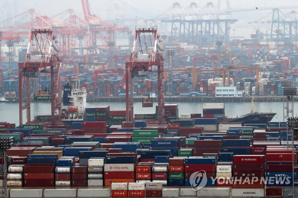 Stacks of import-export cargo containers at South Korea's largest seaport in Busan, 450 kilometers south of Seoul (Yonhap)