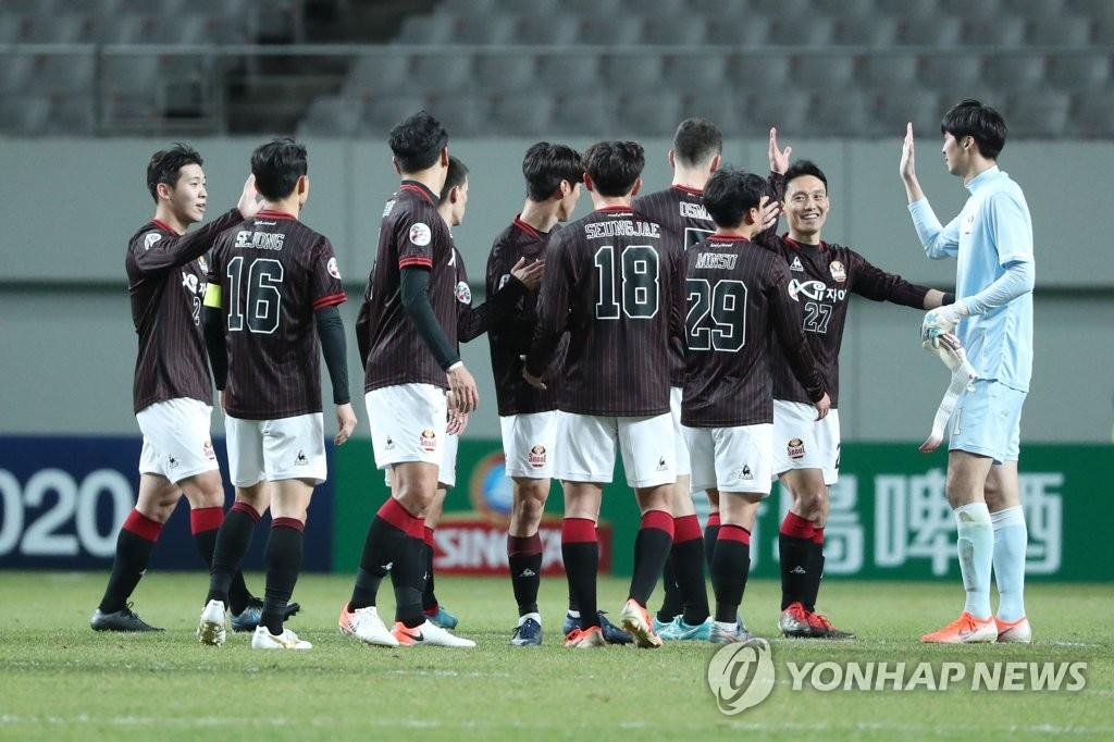 In this file photo from Jan. 28, 2020, FC Seoul players celebrate their victory over Kedah FA in a playoff match for the Asian Football Confederation (AFC) Champions League at Seoul World Cup Stadium in Seoul. (Yonhap)