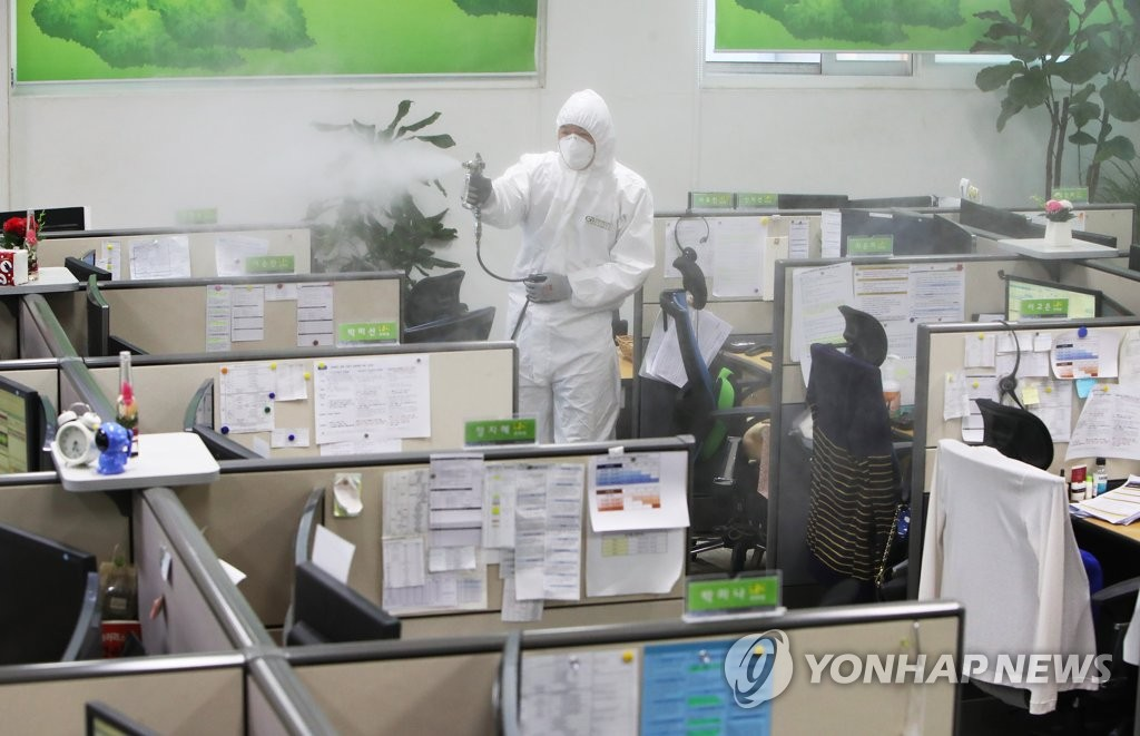 Province officials disinfect a call center run by Gyeonggi Province in Suwon, south of Seoul, on March 11, 2020. (Yonhap)