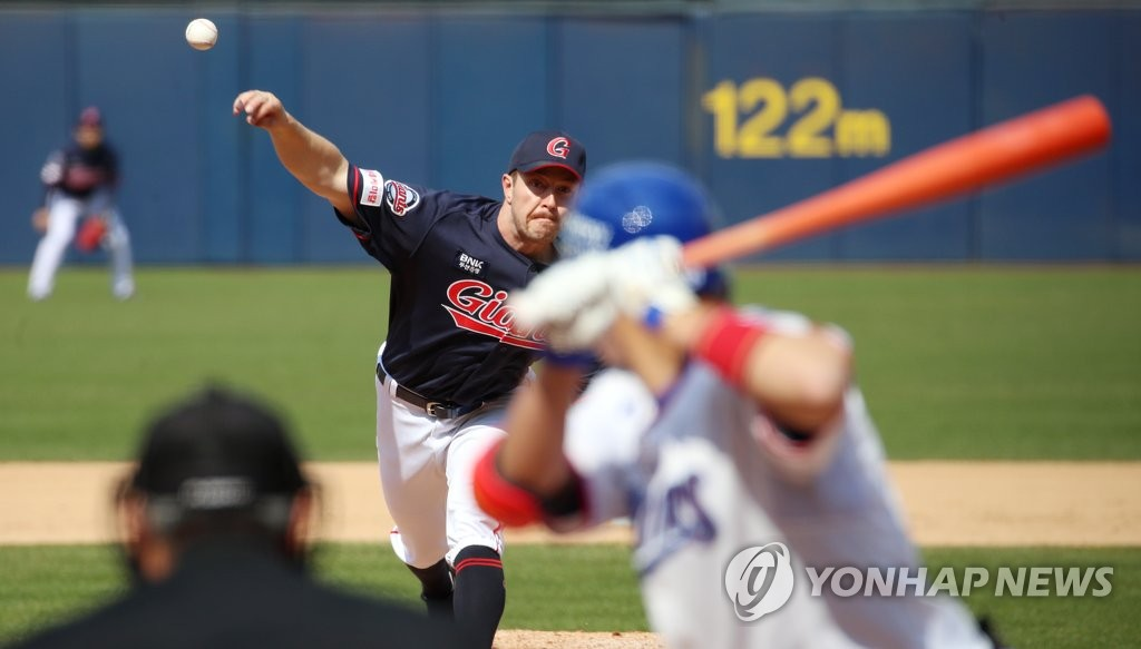 In this file photo from April 27, 2020, Adrian Sampson of the Lotte Giants (L) pitches against the Samsung Lions in a Korea Baseball Organization preseason game at Daegu Samsung Lions Park in Daegu, 300 kilometers southeast of Seoul. (Yonhap)