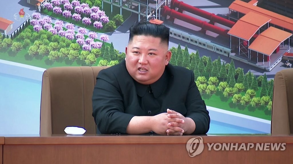 This image, captured from footage of the Korean Central TV Broadcasting Station on May 2, 2020, shows North Korean leader Kim Jong-un attending a ribbon-cutting ceremony at a fertilizer factory in Sunchon, north of Pyongyang. (For Use Only in the Republic of Korea. No Redistribution) (Yonhap)