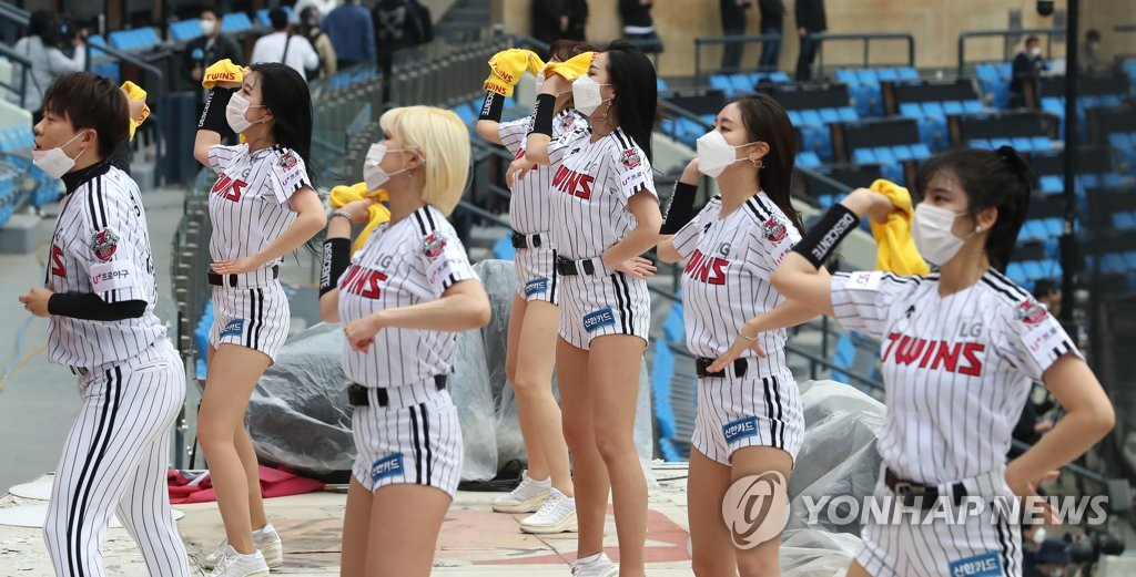 Cheerleaders for the LG Twins root for the home team at Jamsil Stadium in Seoul against the Doosan Bears in their Korea Baseball Organization season opening game on May 5, 2020. (Yonhap)