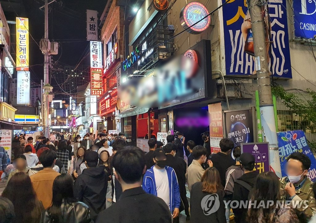 Crowds of people walk around the Seomyeon district of downtown Busan, South Korea's second-largest city, on May 9, 2020. (Yonhap)