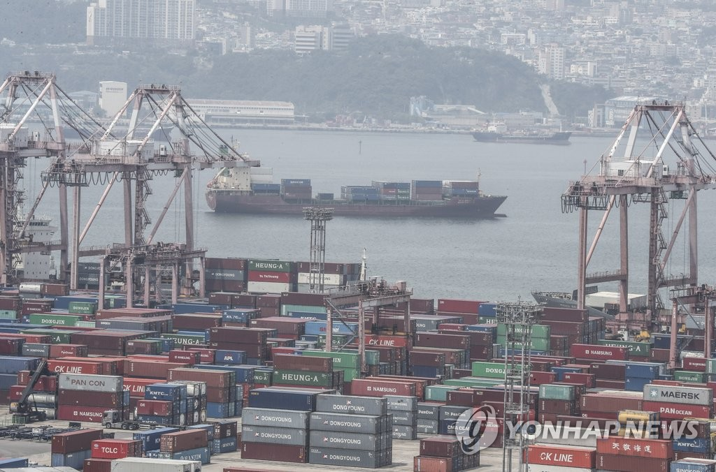 This photo, taken on June 1, 2020, shows containers piling up at a port in the southeastern city of Busan. (Yonhap)