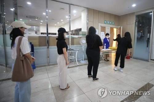 Worshippers keep distance in Gwangju church