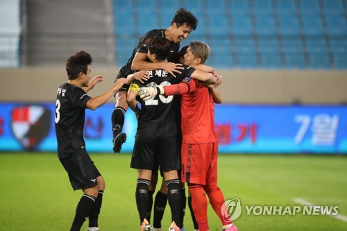 Seongnam FC players celebrate win