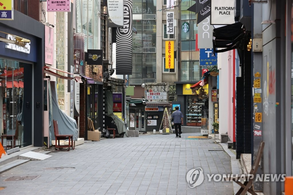 This photo, taken Aug. 23, 2020, shows the empty tourist hot spot of Myeongdong in downtown Seoul after the government strengthened the social distancing level amid spiking COVID-19 cases. (Yonhap)