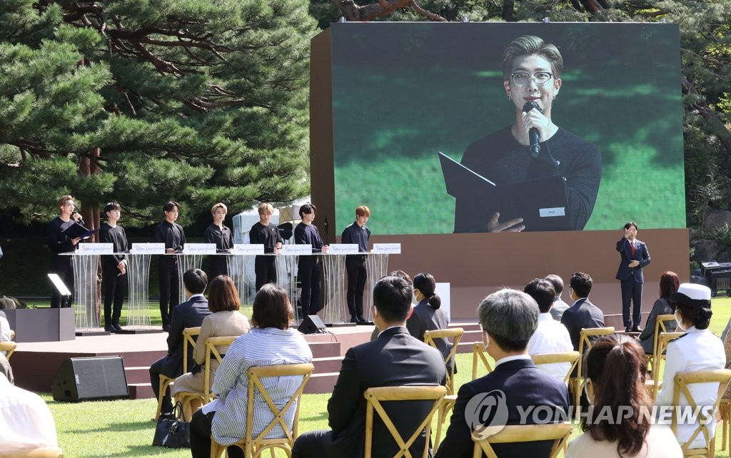 A member of K-pop boy band BTS delivers a speech encouraging younger generations during the inaugural Youth Day event at Nokjiwon, a verdant garden inside the presidential compound Cheong Wa Dae, in Seoul on Sept. 19, 2020. (Yonhap)