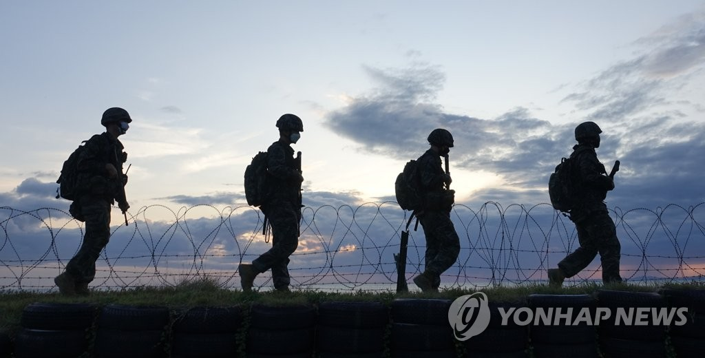 South Korean marines patrol a beach of the western border island of Yeonpyeong on Sept. 25, 2020, amid tensions over North Korea's killing of a South Korean official in its waters on Sept. 22. (Yonhap)