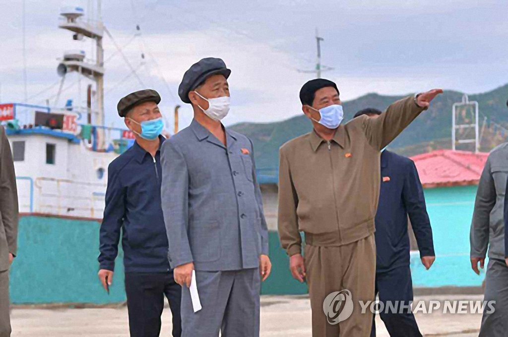 North Korea's Premier Kim Tok-hun (C) inspects a typhoon-hit eastern area and calls for a speedy recovery, in this photo disclosed by the Rodong Sinmun, the official newspaper of the North's ruling party, on Oct. 8, 2020. (For Use Only in the Republic of Korea. No Redistribution) (Yonhap)
