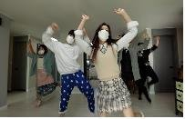 This screenshot, from a campaign video produced by the health ministry, shows a family dancing at home. It triggered a slate of angry comments from people who claimed it could wrongly encourage people to disturb their neighbors. (PHOTO NOT FOR SALE)(Yonhap)