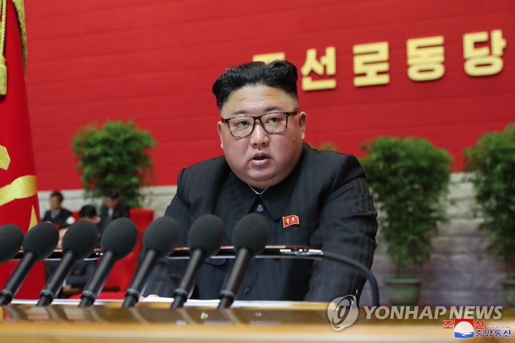 "North Korean leader Kim Jong-un speaks during the third day of the eighth congress of the ruling Workers' Party in Pyongyang on Jan. 7, 2021, in this photo released by the North's official Korean Central News Agency the next day. Kim said he has reviewed inter-Korean relations and declared a policy stance for ""comprehensibly"" expanding external ties. (For Use Only in the Republic of Korea. No Redistribution) (Yonhap)"