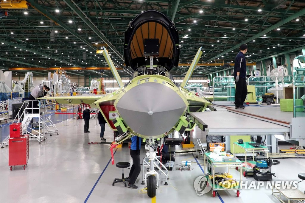 Workers of Korea Aerospace Industries (KAI) assemble a prototype of South Korea's first indigenous fighter jet KF-X at its plant in the southeastern city of Sacheon on Feb. 24, 2021, in this photo provided by the Kookbang Ilbo newspaper. (PHOTO NOT FOR SALE) (Yonhap)