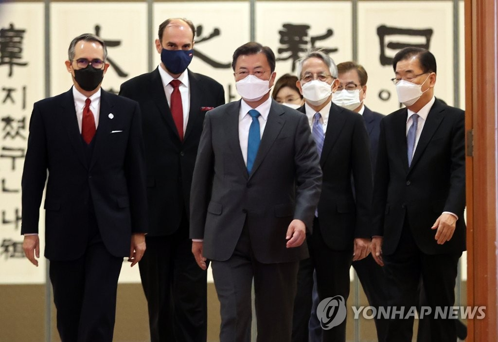South Korean President Moon Jae-in (C) walks toward a meeting room at Cheong Wa Dae in Seoul after receiving credentials from the new ambassadors of Japan, Dominica and Latvia. (Yonhap)