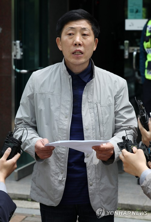 Police raid defector activist's office