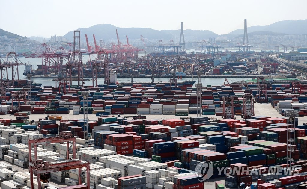 Cargo containers are stacked at a port in Busan, 453 kilometers southeast of Seoul, on June 1, 2021, in this file photo. (Yonhap)