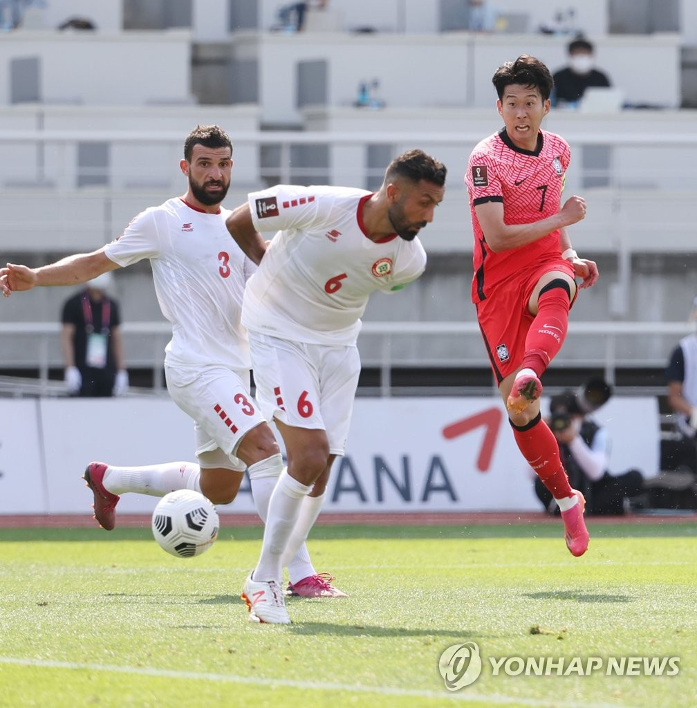 Son Heung-min of South Korea (R) takes a shot past Maher Sabra (L) and Joan Oumari of Lebanon during the teams' Group H match in the second round of the Asian qualification for the 2022 FIFA World Cup at Goyang Stadium in Goyang, Gyeonggi Province, on June 13, 2021. (Yonhap)