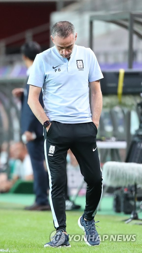 South Korea head coach Paulo Bento puts his head down during the team's Group A match against Iraq in the final Asian qualifying round for the 2022 FIFA World Cup at Seoul World Cup Stadium in Seoul on Sept. 2, 2021. (Yonhap)